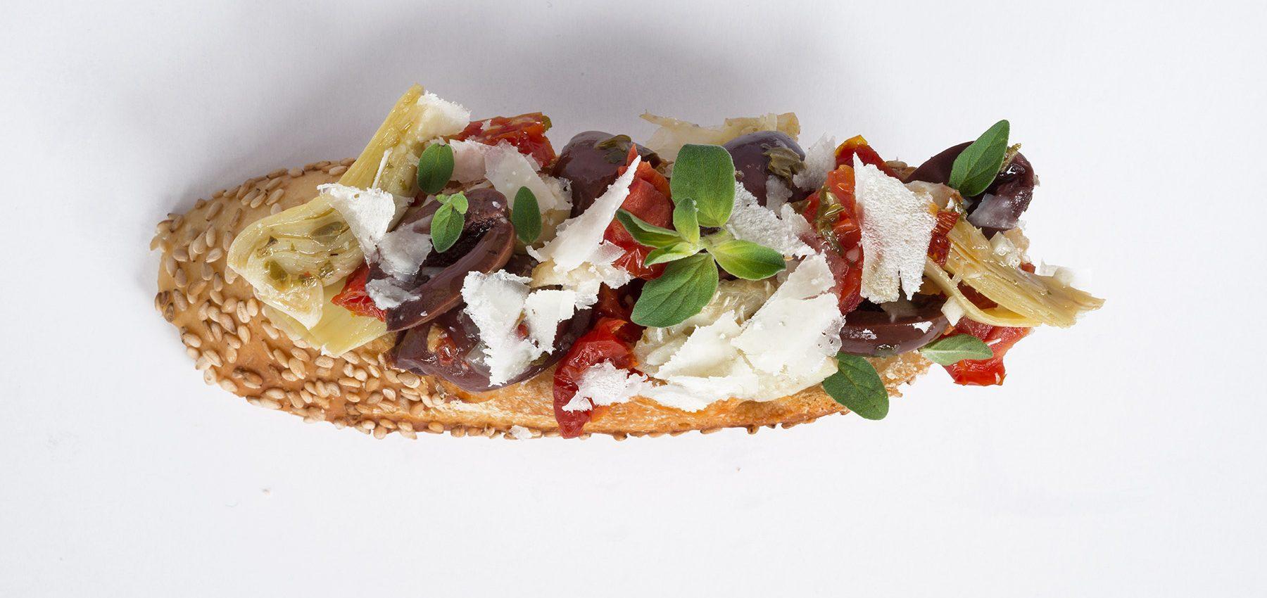 Artichoke and Olive Crostini Home » Artichoke and Olive Crostini